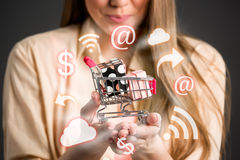 Shopping chart in hands surrounds shopping icons Royalty Free Stock Photo