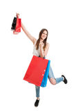 Shopping cheerful young woman holding colored bags over her head Stock Images