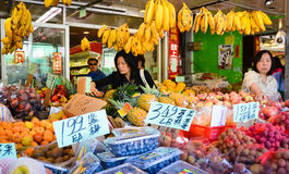 Shopping in Chinatown San Franisco. Asian women shop for vegetables and fruit at an outdoor market in San Francisco's Chinatown Stock Image