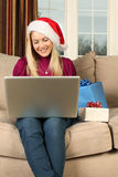 Shopping for Christmas gifts online Royalty Free Stock Photos