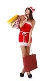 Shopping at Christmas. Happy Christmas girl holding shopping bags Stock Photo
