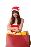 Shopping at Christmas. Happy Christmas girl holding shopping bags Stock Photography