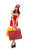 Shopping at Christmas. Happy Christmas girl holding shopping bags Royalty Free Stock Images
