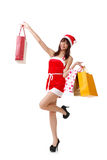 Shopping at Christmas. Happy Christmas girl holding shopping bags Royalty Free Stock Photography