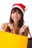 Shopping at Christmas. Happy Christmas girl holding shopping bags Royalty Free Stock Photos