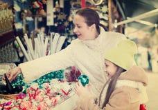 Shopping at the Christmas market Stock Photos