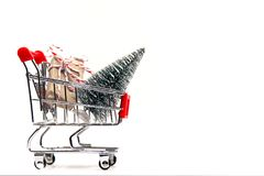 Shopping Christmas and New year , gift box and christmas tree in the shopping cart. royalty free stock images