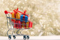 Shopping Christmas and New year , gift box and christmas tree in the shopping cart. stock photo