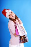 Shopping Christmas woman smiling. Royalty Free Stock Images