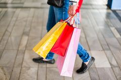 Couple Holding Colorful Shopping Bags Royalty Free Stock Photos