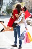 Young couple in love outdoor hugging. Shopping in the city. Lovely couple having fun on the Macedonian streets, on a sunshine day royalty free stock photo