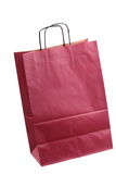 Shopping claret, claret-coloured gift bags and apple isolated Royalty Free Stock Images
