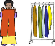 Shopping For Clothes. Female shopper comparing clothes on isolated background Stock Photography