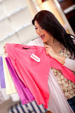 Shopping for clothes on sale Royalty Free Stock Image