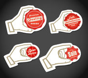 Shopping colorful discount labels. In a hand Royalty Free Stock Photo