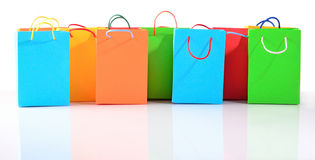 Shopping colorful sale paper bags close-up on a white Royalty Free Stock Image
