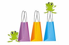 Shopping,. The composition of bags shopping and green frogs Royalty Free Stock Photography