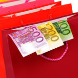 Shopping concept. Close up photo of money attached to shopping bag Stock Photography