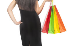 Shopping Concept: Back of Caucasian Woman Holding Shopping Bags Stock Photos