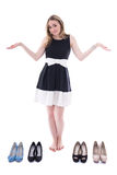 Shopping concept - beautiful woman choosing shoes isolated on wh Stock Image