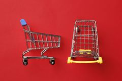 Shopping cart on a red  background royalty free stock photography
