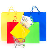 Shopping concept. Colorful bags and cart with cash Stock Image