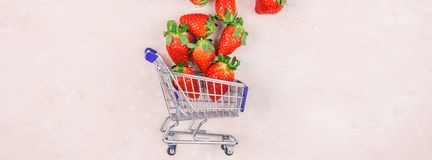 Shopping concept composition with strawberries. Creative Shopping concept composition flat lay top view love holiday celebration with red strawberries pink stock images