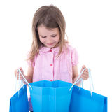 Shopping concept - cute little girl with bags isolated on white Stock Photo