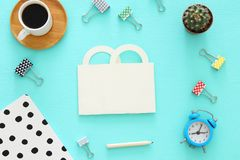 Shopping concept with paper bag and office supply. Flat lay, Top view. Royalty Free Stock Photography