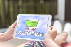 Shopping concept on a tablet. Female hands holding a tablet with shopping concept stock photos