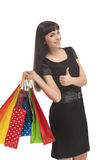 Shopping Concept: Thumbs Up of Brunette Woman Stock Images