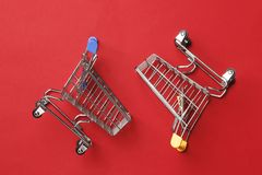 Wo shopping carts on a red background royalty free stock photos