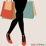 Shopping concept with woman silhouette carrying shopping bags Stock Photos