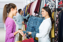 Shopping consultant and clients Stock Images