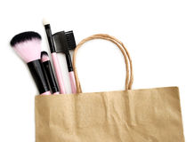 Shopping cosmetic brushes in paper bag isolate on white Royalty Free Stock Images