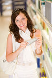 Shopping cosmetics - woman with moisturizer Royalty Free Stock Photos