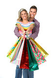 Shopping couple. Shopping  couple  smiling. Isolated over white background Royalty Free Stock Photo