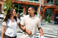 Shopping: Couple With Bags Walking And Talking stock photography