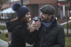 Shopping couple drinking coffee stock photo