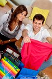 Shopping couple at home Stock Images