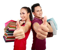 Shopping couple showing thumb up Royalty Free Stock Image