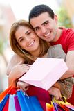 Shopping couple smiling Stock Photos