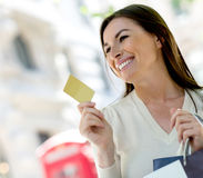 Shopping with a credit card Royalty Free Stock Images