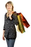 Shopping day. Blonde with blue eyes taking shopping bags. Isolate on white Stock Photography