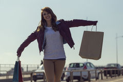 Shopping day. Beautiful, young brunette walking and feeling happy after successful shopping Stock Photos