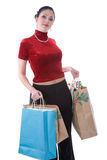Shopping day gift bags. A young attractive woman carrying several carrier bags of gifts Royalty Free Stock Image