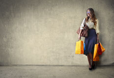 Shopping day. Happy woman doing shopping carrying several bags Stock Image