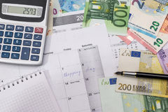 Shopping day written in the planner with euro bills, Stock Image