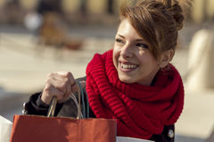 Shopping day. Young beautiful girl carrying shopping bags,outdoors Stock Photos