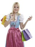 Shopping Dirndl. Woman in Dirndl with Shopping Bags stock photo